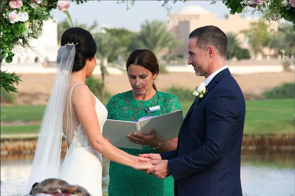 Wedding Ceremony couple with celebrant
